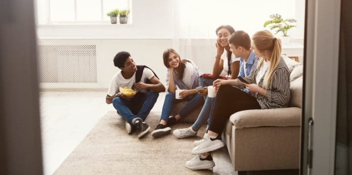 Best Conversation Starters - over 80 questions to start a conversation - teens sitting and talking